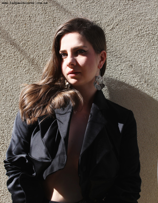 Lady Melbourne wearing Sonya Kraan black jacket