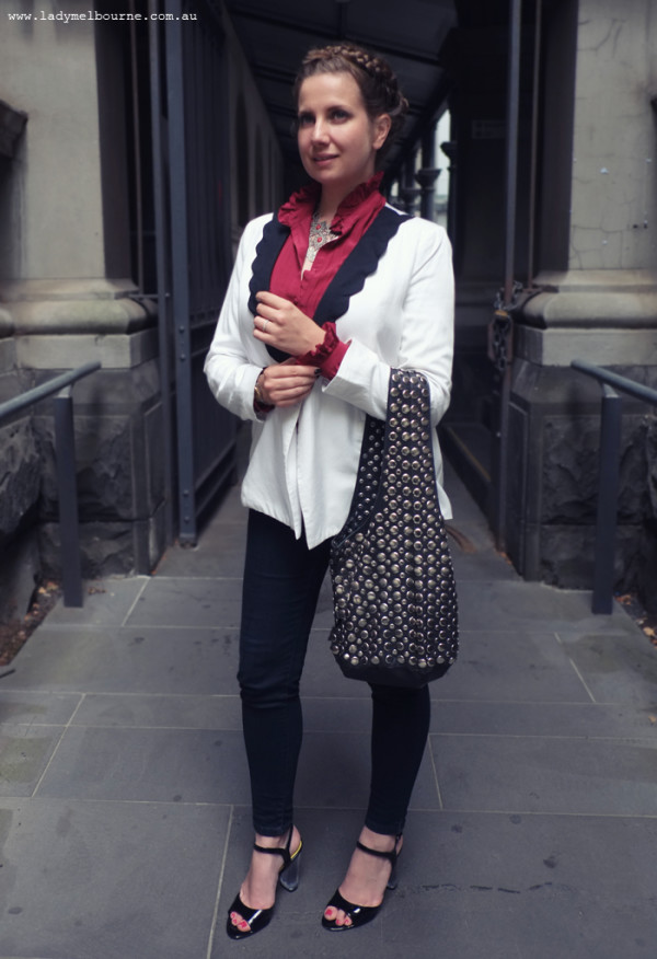 Lady Melbourne's white blazer, studded bag and lucite heels