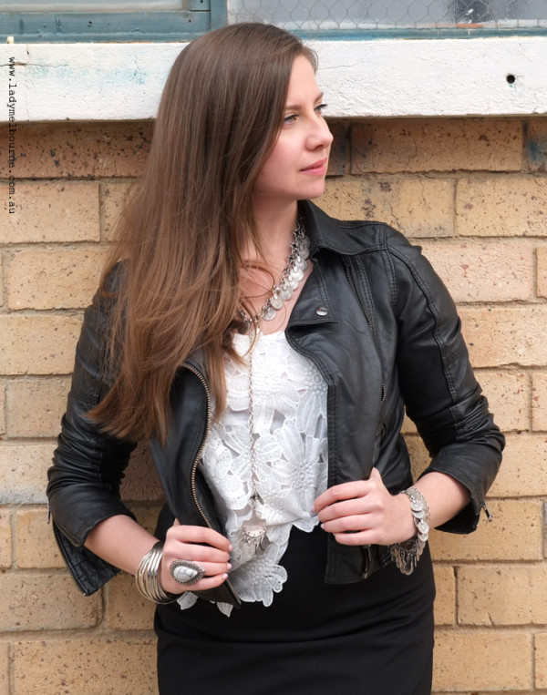 Lady Melbourne in black motorcycle jacket with silver accessories