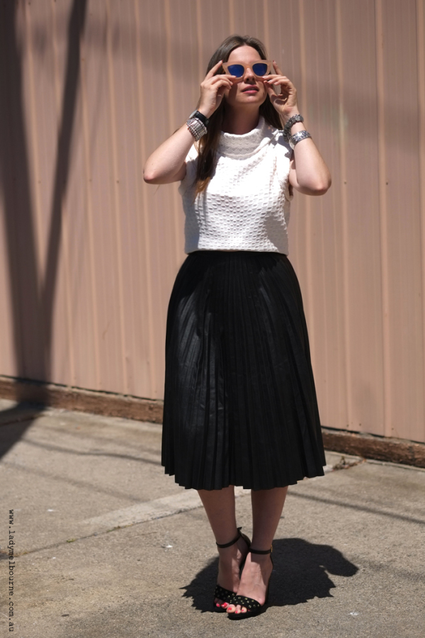 Lady Melbourne wearing pleather skirt by Chicwish.com