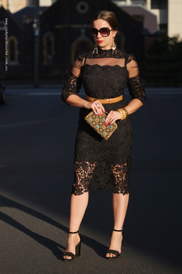 Black lace top and skirt worn as a dress