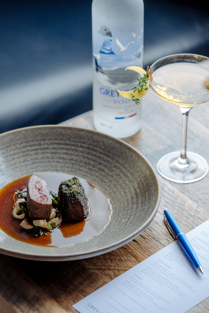 Wagyu beef fillet and cheek, soy and roasted onion consommé, wakame and mushroom fricassee with Pacific Oyster and sesame seed crunch