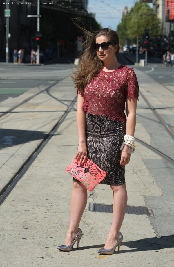 Lady Melbourne wearing a Snake print skirt from Feathers boutique