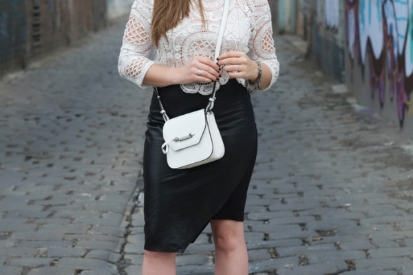 Lady Melbourne wearing 'Once Was' leather skirt with a lace crop top and Mackage bag