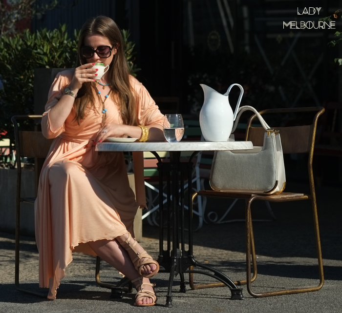 Lady Melbourne trying the coffee at Baked goods at Latte and pastries at Cakes prepared by Lisa Van Zanten at Delicious espresso coffee at Retro teapot at Retro drinks trolley at Mill & Bakery at Central Pier, Docklands in Melbourne