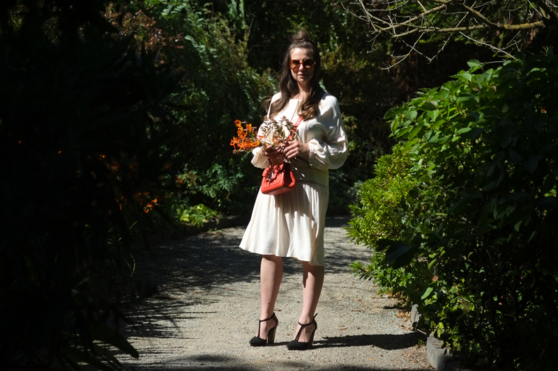 Lady Melbourne wearing MESOP dress with Trussardi Bag