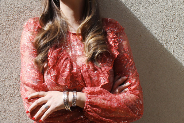Closet London lace blouse with glossy, wavy hair